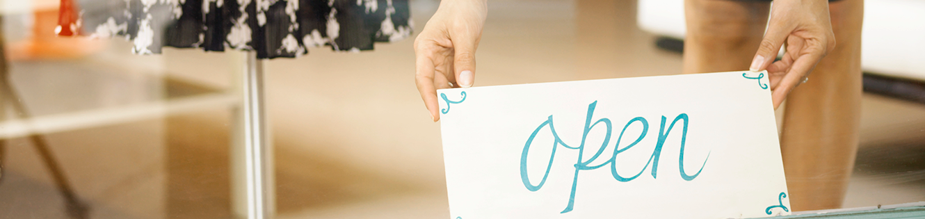 woman holding open sign header image
